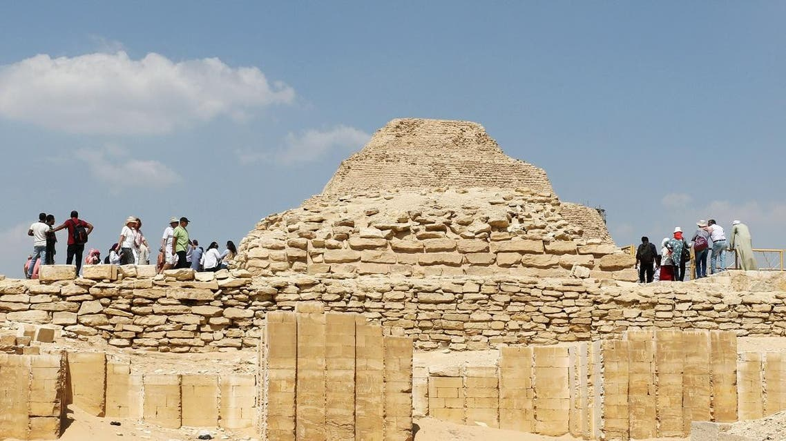 Tourists are seen around Saqqara pyramid at Saqqara area near Egypt's Saqqara necropolis, in Giza, Egypt. (Reuters)