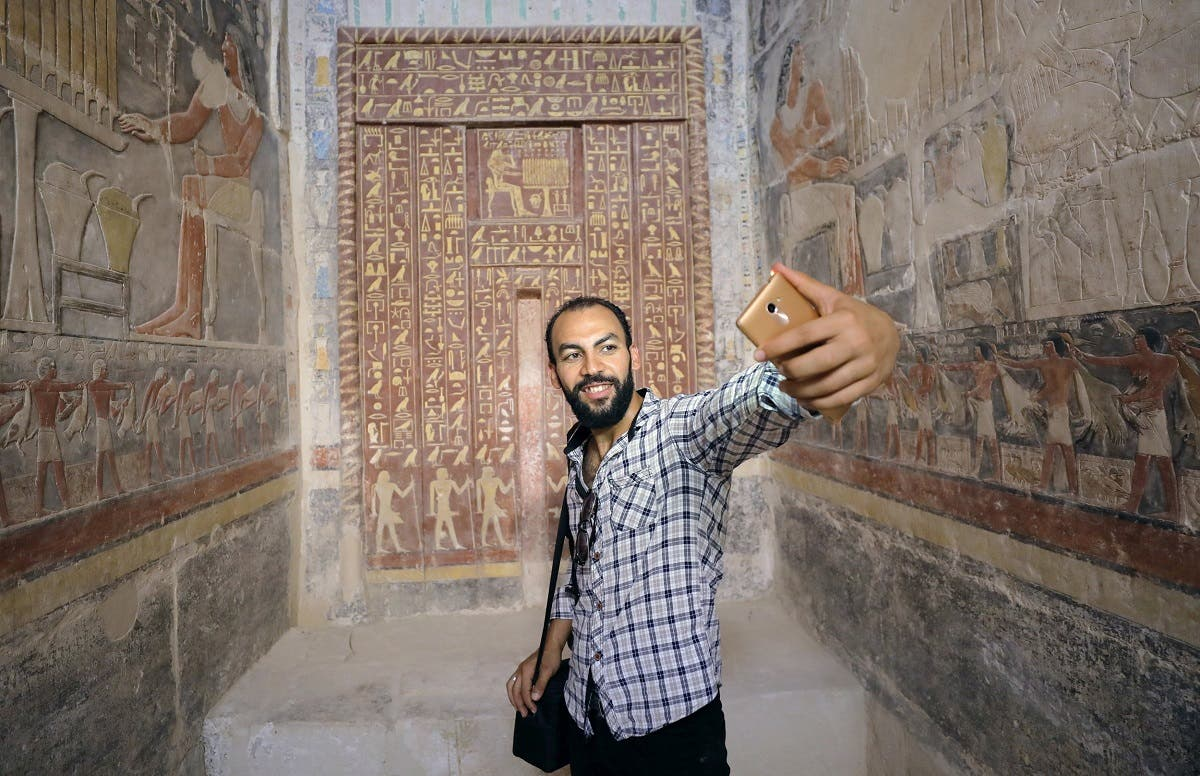 A man takes a selfie in a chamber of the tomb of Mehu, after it was opened for the public at Saqqara area near Egypt's Saqqara necropolis, in Giza. (Reuters)