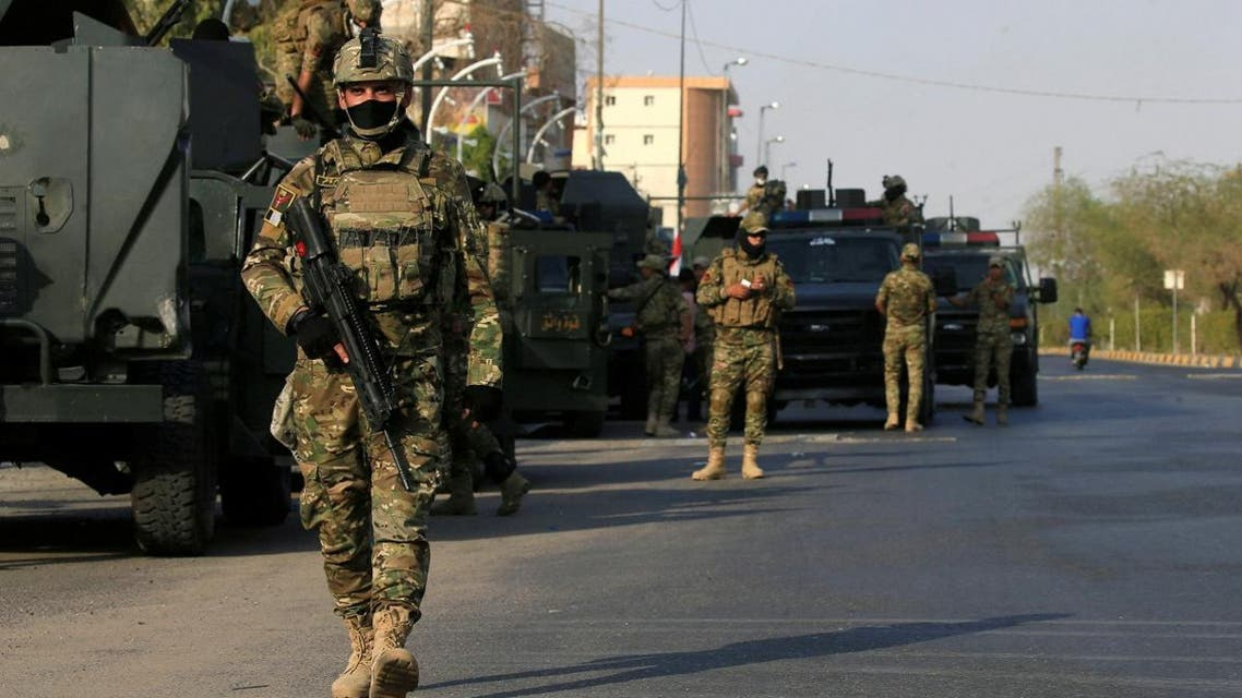 Iraqi rapid response force members guard a street in Basra. (Reuters)