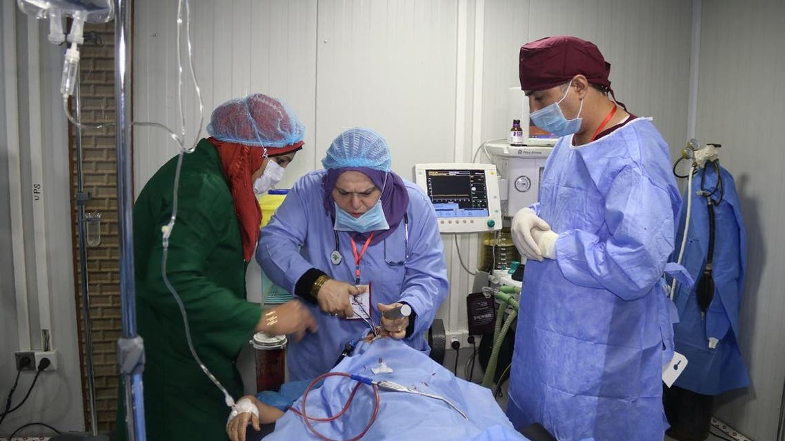 Surgeons operate on a patient at the al-Jamhuri hospital complex in Mosul. (AFP)