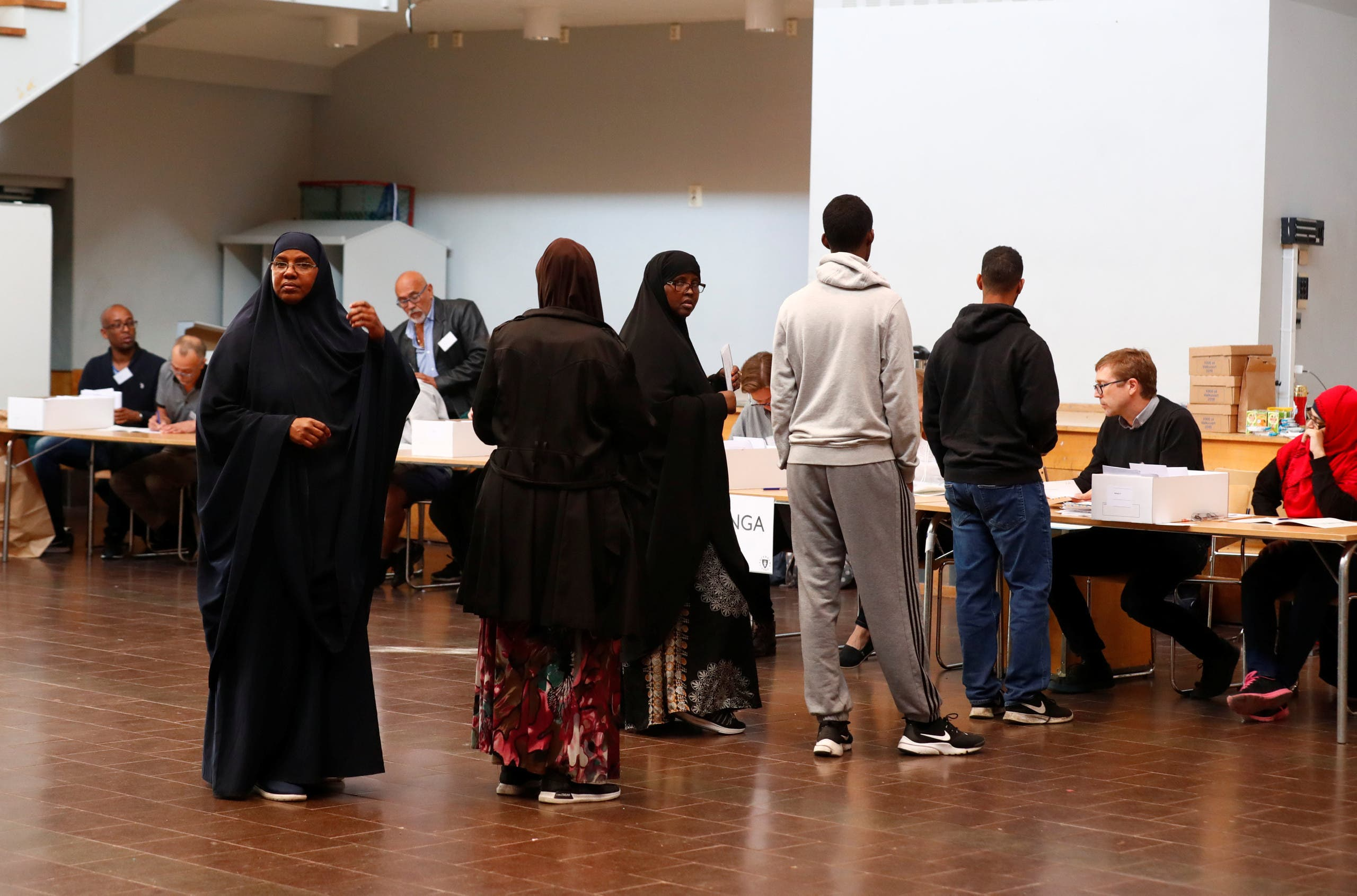 People arrive at a polling station during a general election, in the Rinkeby neighbourhood in Stockholm. (AP)