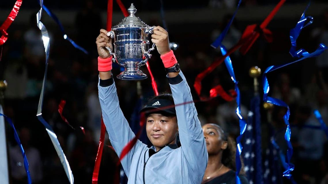Naomi Osaka holds the trophy after defeating Serena Williams in the US Open final. (AP)