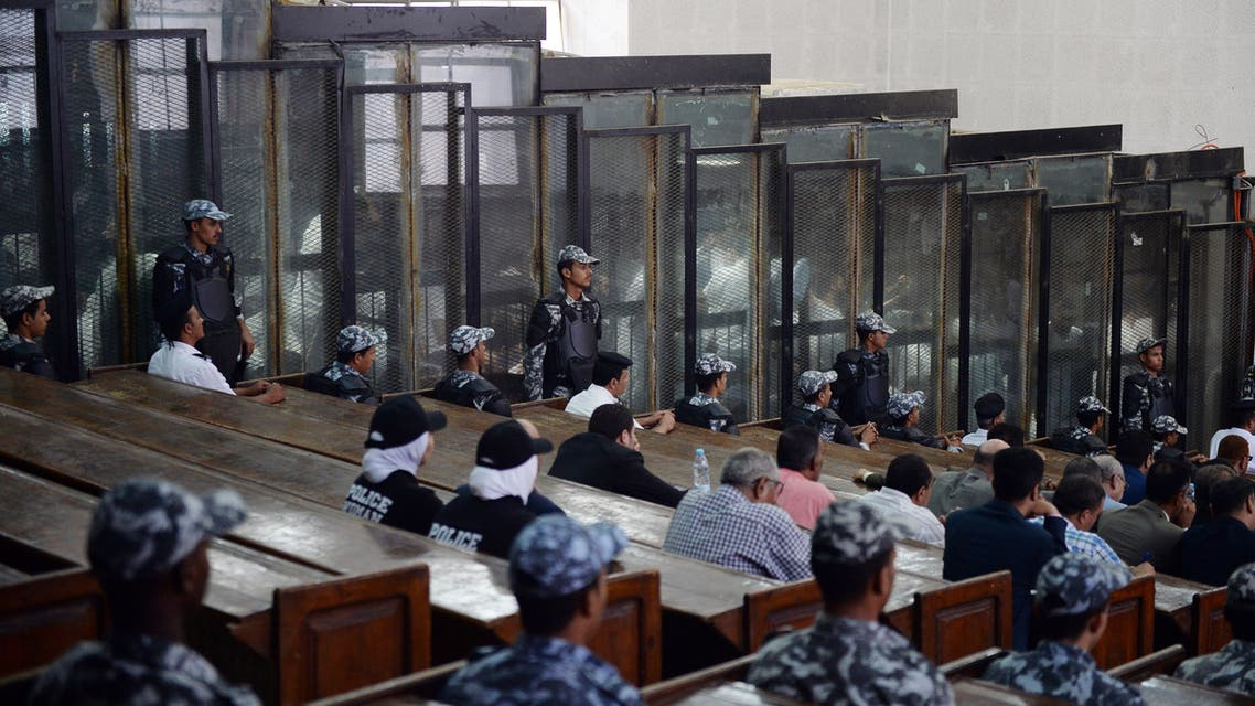 This picture shows the courtroom and soundproof glass dock (bottom) during the trial of 700 defendants including Egyptian photojournalist Mahmoud Abu Zeid, widely known as Shawkan, in the capital Cairo, on September 8, 2018. An Egyptian court on September 8 handed a five-year jail sentence to prominent photojournalist Zeid, known as Shawkan, who earlier this year received UNESCO's World Freedom Prize. Shawkan was one of more than 700 defendants on trial in the same case, most of them facing charges of killing police and vandalising property during the clashes. The same court that jailed him also confirmed on Saturday death sentences initially issued in July against 75 defendants, including leaders of Morsi's outlawed Muslim Brotherhood.