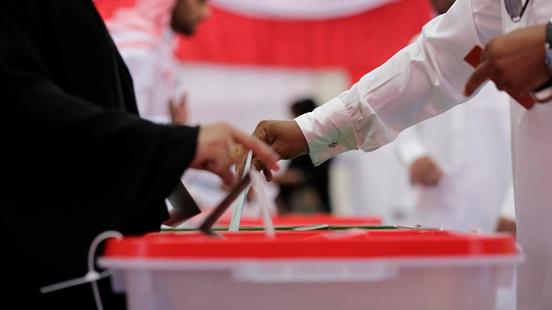 Bahrainis vote at a polling station in a pro-government area in Riffa, Bahrain, Saturday, Nov. 22, 2014. (AP)