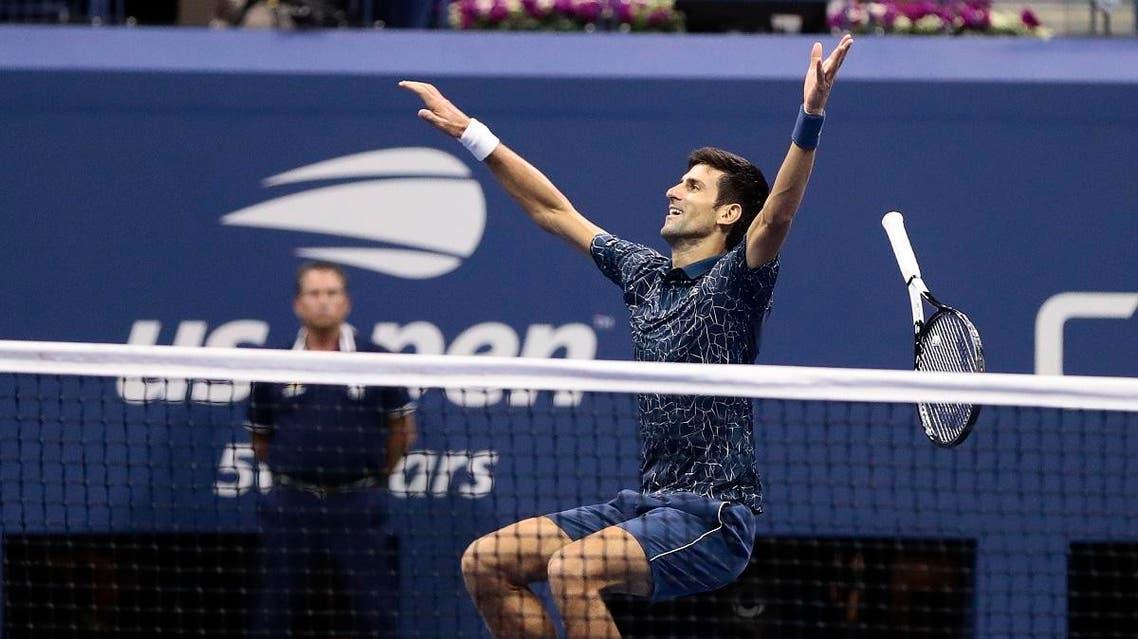 Novak Djokovic celebrates after defeating Juan Martin del Potro. (AP)