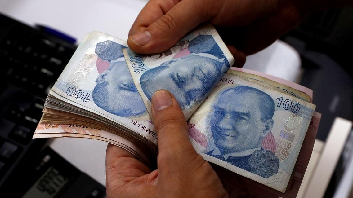 A money changer counts Turkish lira banknotes at a currency exchange office in Istanbul. (Reuters)