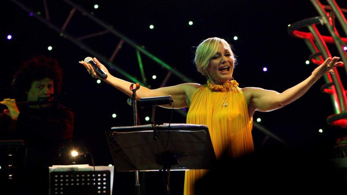 Iranian singer Googoosh, whose real name is Faegheh Atashin, salutes the audience during a rare concert she gave in the Iraqi Kurdish city of Erbil. (AFP)