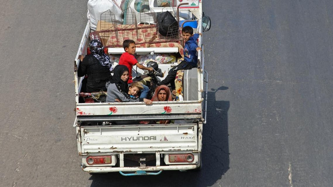 Residents of the Idlib province flee toward the Syrian Turkish border. (AFP)