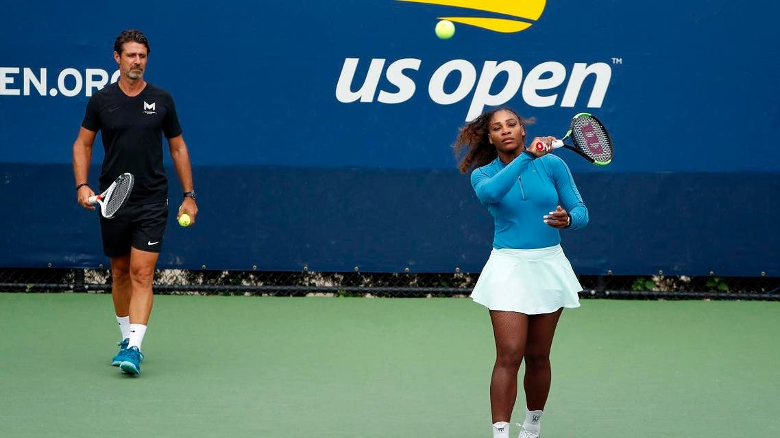 Serena Williams walks on a practice court with her coach Patrick Mouratoglou during the third round of the U.S. Open tennis tournament, Friday, Aug. 31, 2018. (AP)