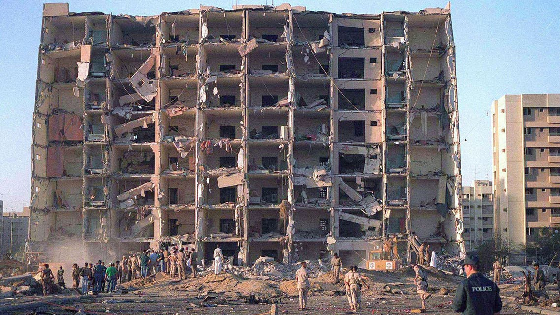 FILE PHOTO: Investigators inspect the Khobar Towers military complex after an attack in Khobar, Saudi Arabia in June 1996. Dept.of Defense/Handout/File Photo via REUTERS. ATTENTION EDITORS - THIS IMAGE WAS PROVIDED BY A THIRD PARTY