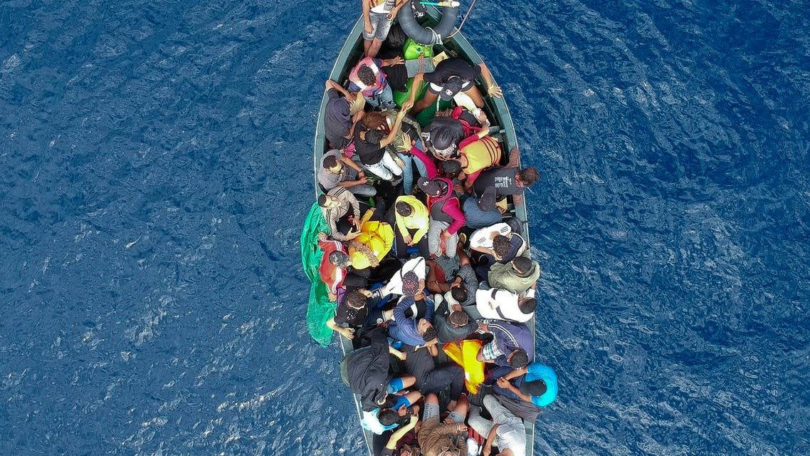 An aerial photo shows a boat carrying migrants stranded in the Strait of Gibraltar before being rescued by the Spanish Guardia Civil and the Salvamento Maritimo sea search and rescue agency that saw 157 migrants rescued on September 8, 2018. While the overall number of migrants reaching Europe by sea is down from a peak in 2015, Spain has seen a steady increase in arrivals this year and has overtaken Italy as the preferred destination for people desperate to reach the continent. Over 33,000 migrants have arrived in Spain by sea and land so far this year, and 329 have died in the attempt, according to the International Organization for Migration.