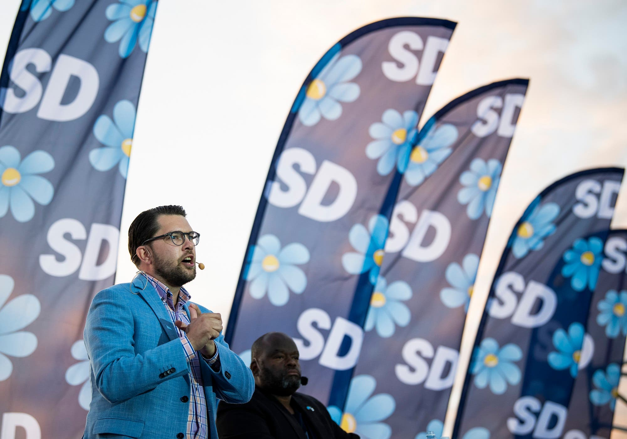 The party leader of the far-right Sweden Democrats, Jimmie Akesson, gives a speech during a campaign meeting in Stockholm on September 8, 2018. (AFP)