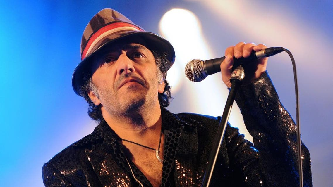Algerian singer Rachid Taha performs, on June 21, 2009 in Toulouse, southwestern France for the 15th edition of the Rio Loco festival. (AFP)