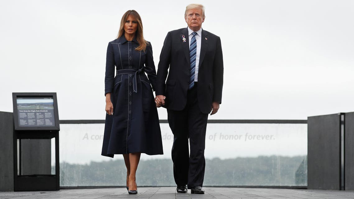 """U.S. President Donald Trump holds hands with first lady Melania Trump as they walk away from the """"Flight Path Overlook"""" at the Flight 93 National Memorial during the 17th annual September 11 observance at the memorial near Shanksville, Pennsylvania, U.S., September 11, 2018. REUTERS/Kevin Lamarque"""