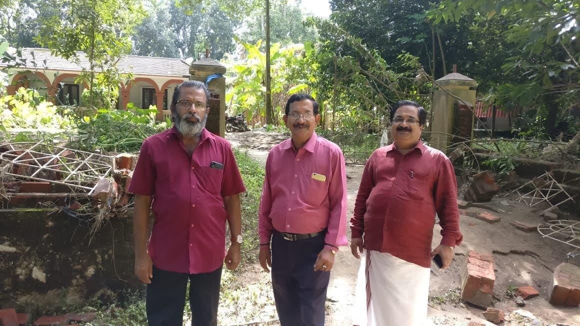 Ahmedabad Kerala Samajam General Secretary C.V. Narayanan (extreme right) and vice president N S Nair (center) visited many interior rain-ravaged areas. (Supplied)