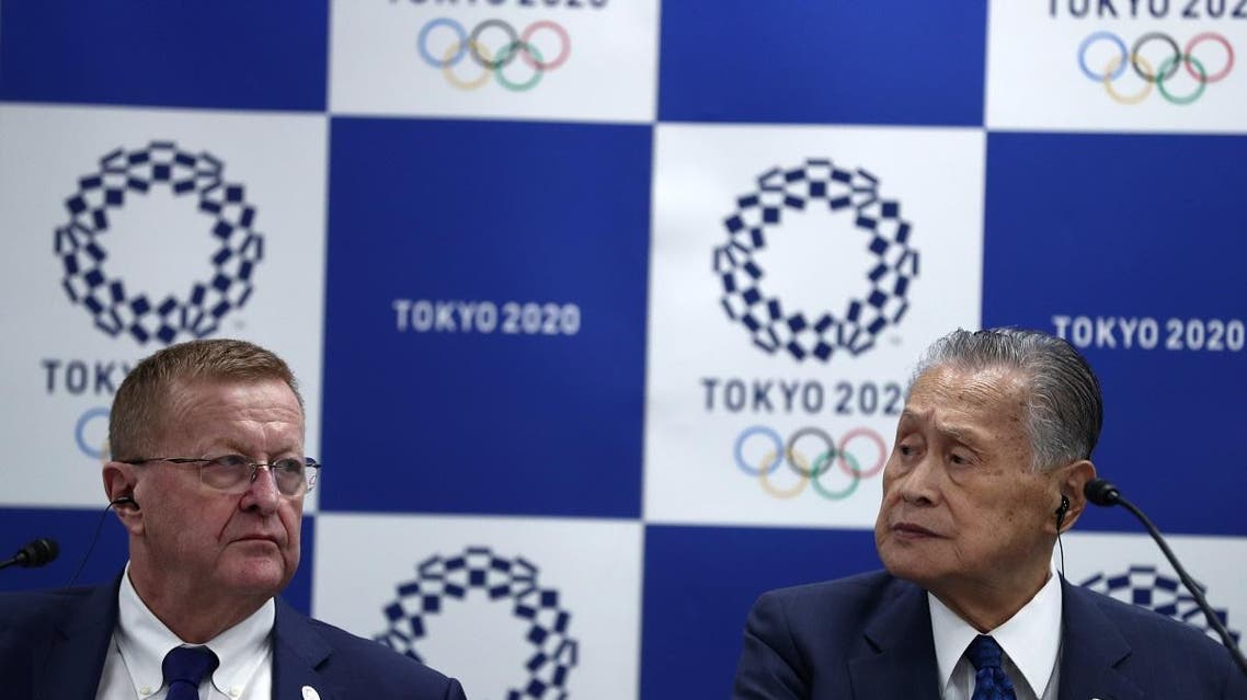 International Olympic Committee vice president and chairman of the Coordination Commission for Tokyo 2020, John Coates (L), and Tokyo 2020 president Yoshiro Mori (R) attend a joint press conference in Tokyo. (AFP)