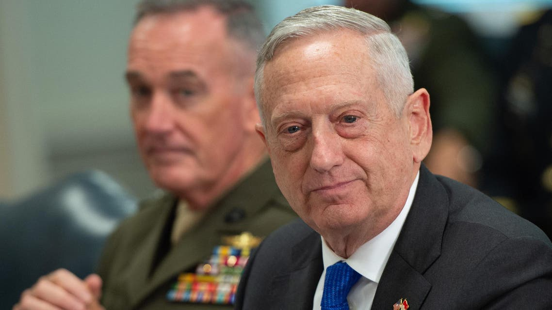 """(FILES) In this file photo taken on August 28, 2018 US Secretary of Defense Jim Mattis speaks alongside Chairman of the Joint Chiefs of Staff General Joseph Dunford (L) as he holds a meeting with Indonesia Defense Minister Ryamizard Ryacudu at the Pentagon in Washington, DC. US Defense Secretary Jim Mattis is not a fan of appearing on television and he would rather not see his name in the newspaper. In other words, the former Marine general likes to do keep his head down and do his job with the least fuss a top member of President Donald Trump's cabinet can muster.But this week, the Pentagon chief found himself smack in the middle of a media firestorm in Washington. Veteran political reporter Bob Woodward, in his new book about Trump, describes a White House mired in a perpetual """"nervous breakdown"""", with staff battling to corral the angry impulses of a paranoid leader."""
