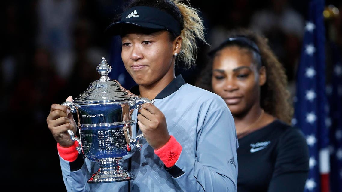 Osaka holds the trophy after defeating Serena Williams in the US Open in New York on Sept. 8, 2018. (AP)