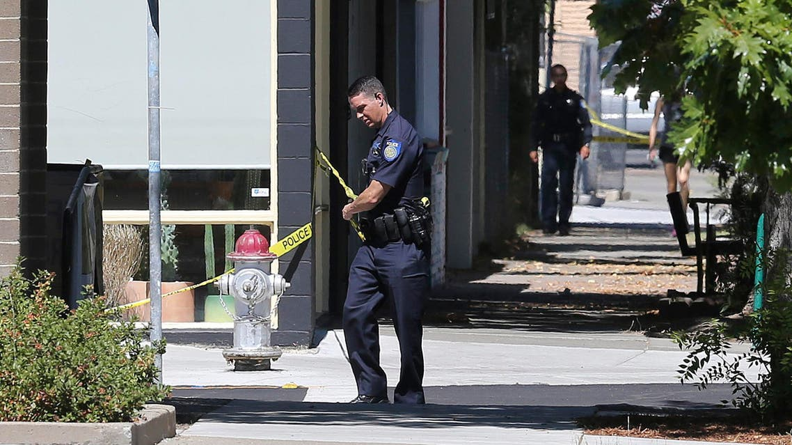 A police officer strings tape near the scene where a man was shot and killed by police on Sept. 6, 2018, in California. (File photo: AP)