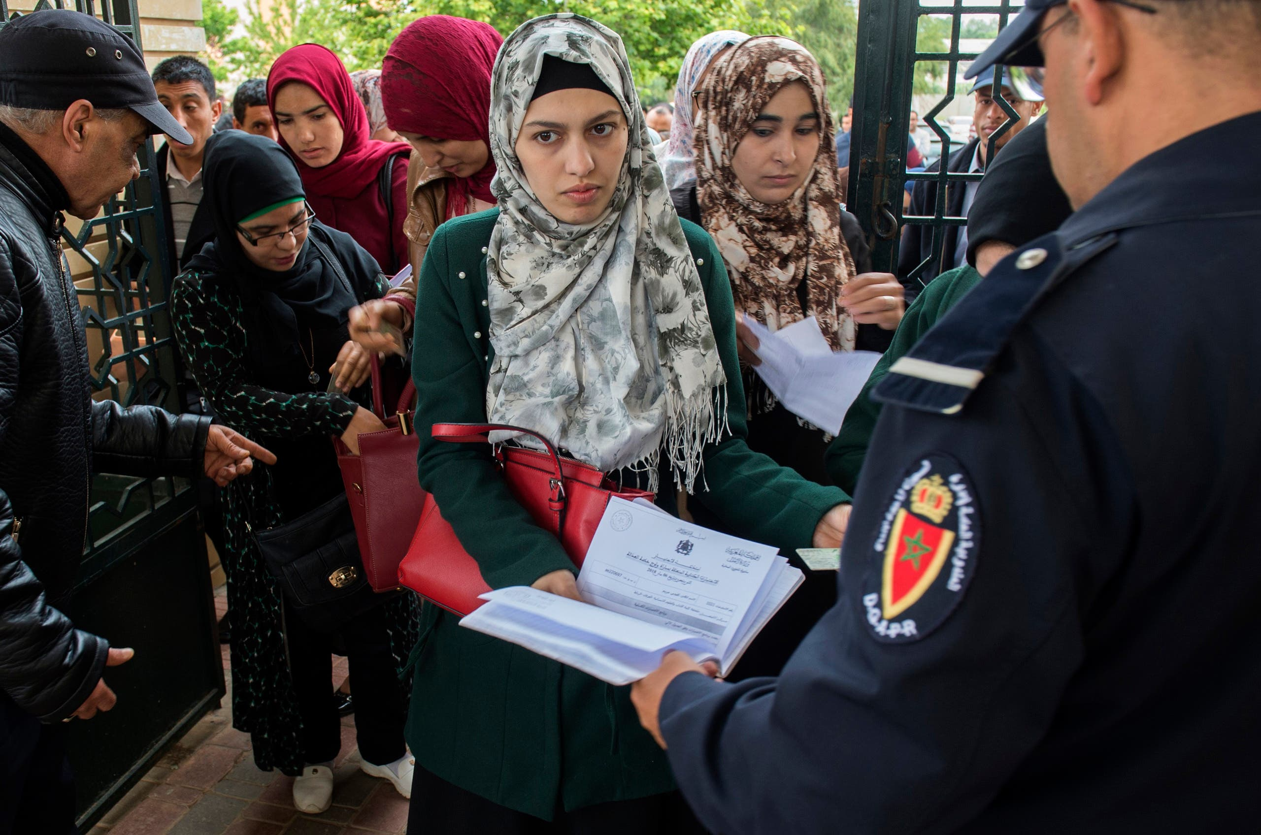 Moroccan women arrive to sit an exam to become a notary in Islamic law, in Rabat on May 6, 2018, after the position was opened to women for the first time in Morocco. (AFP)