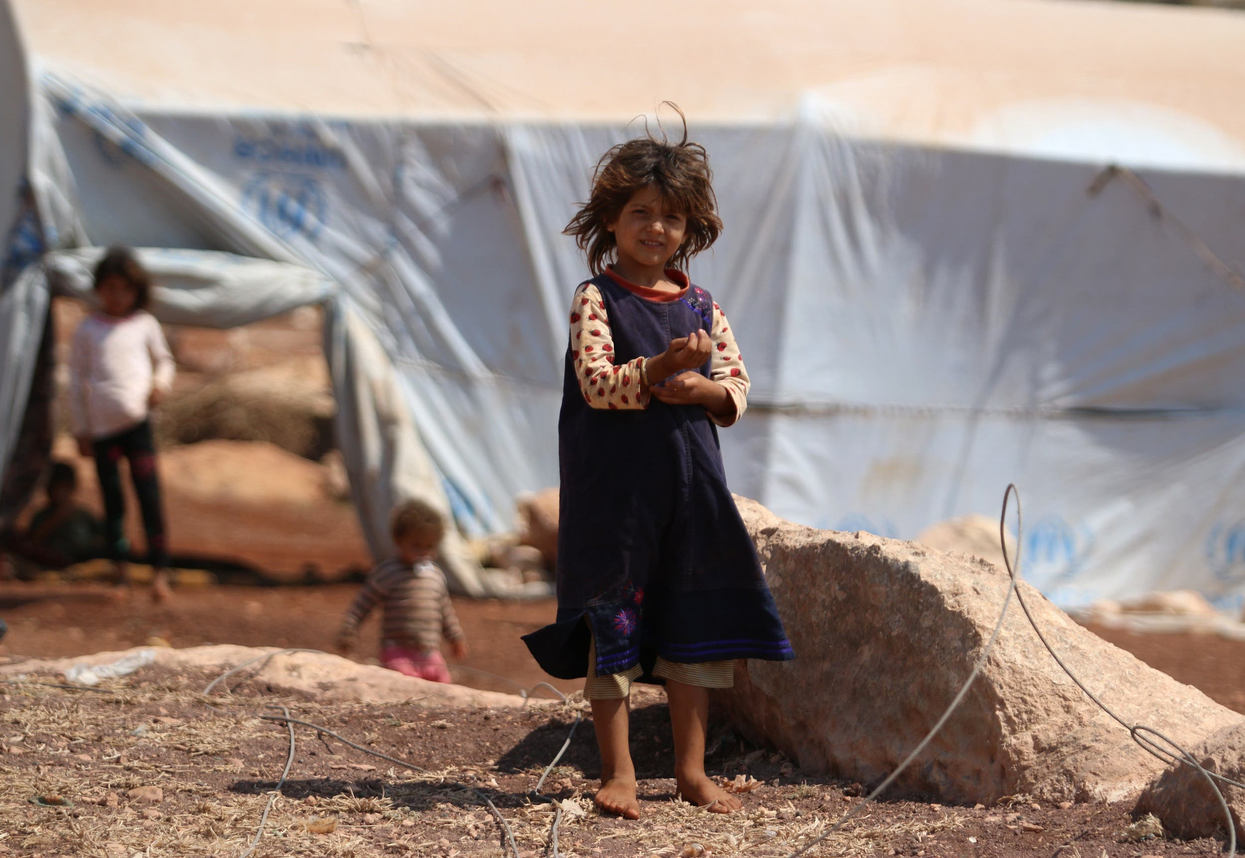 A displaced Syrian girl outside her camp in Kafr Lusin near the border with Turkey in the northern part of Idlib on September 9, 2018. (AFP)