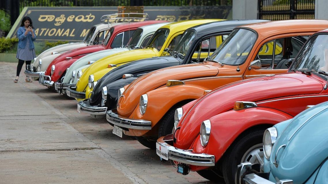 """In this file photo taken on June 24, 2018 vintage Volkswagen Beetle cars are parked in a row during a rally held as part of the 23rd anniversary of """"World Wide VW Beetle Day"""", in Bangalore, India. (AFP)"""