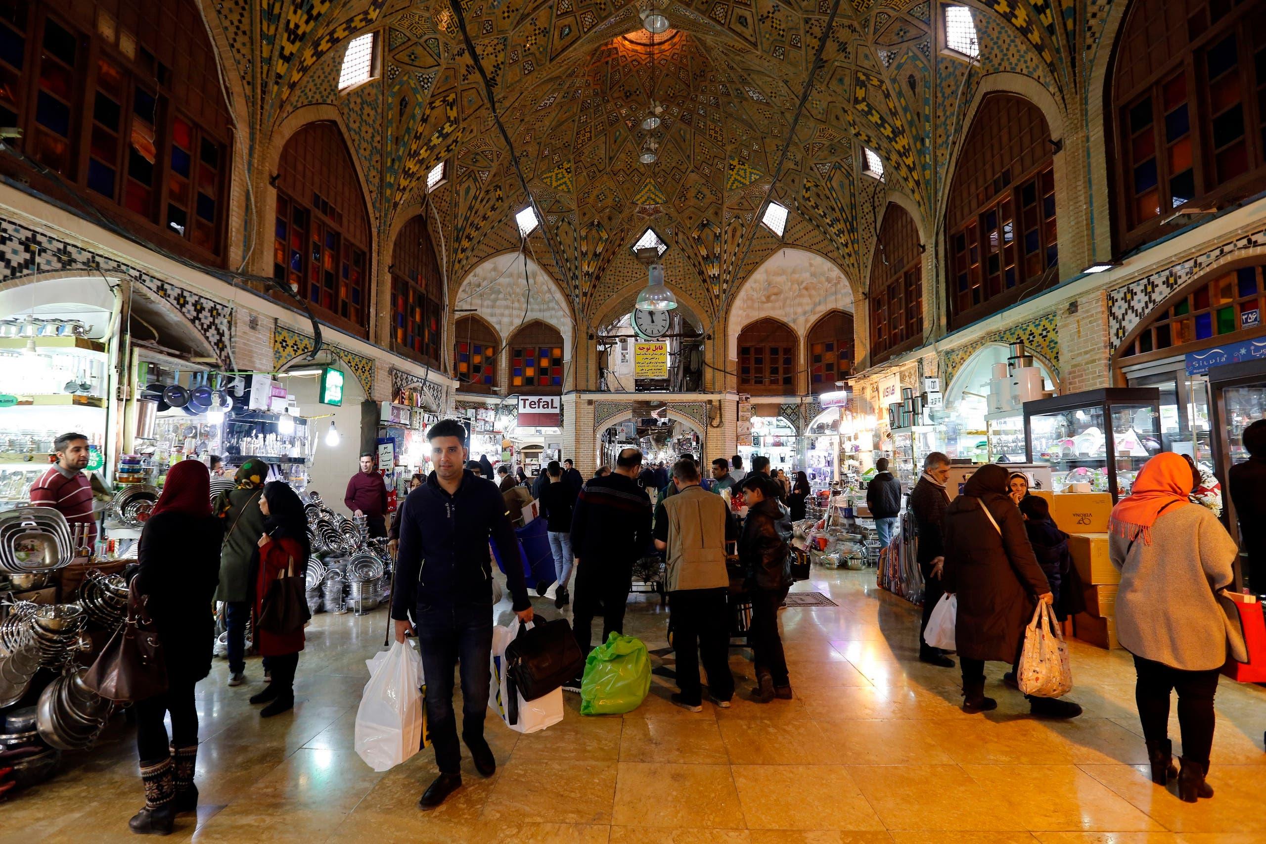 Iranians shop at Tehran's ancient Grand Bazaar on January 4, 2018. (AFP)