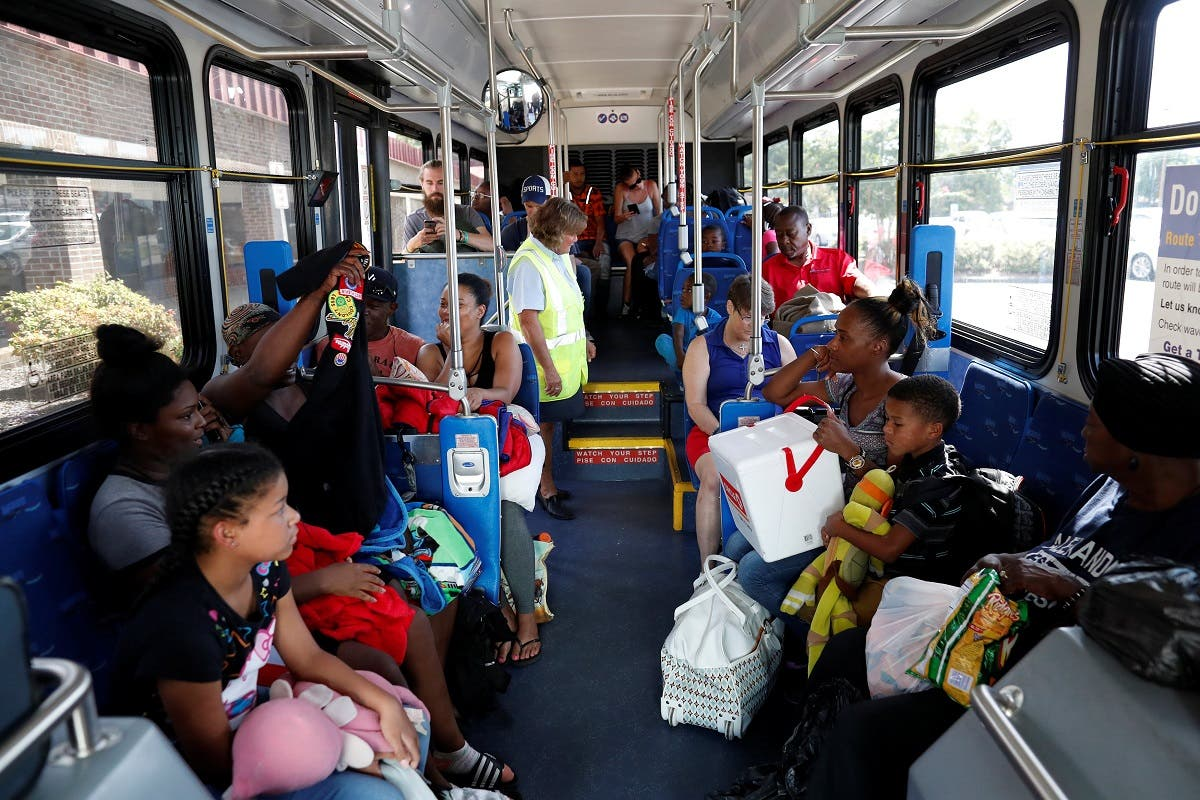 People wait before departure on an evacuation bus ahead of the arrival of Hurricane Florence in Wilmington, North Carolina, US, on September 12, 2018. (Reuters)