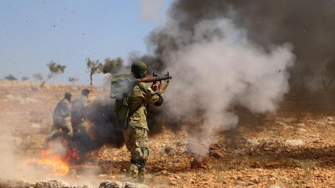 """A Syrian rebel fighter from the recently-formed """"National Liberation Front"""" takes part in combat training in the northern countryside of the Idlib province on September 11, 2018. (AFP)"""