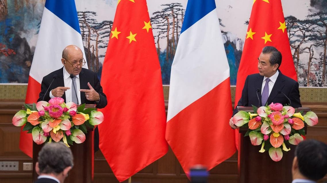 French Foreign Affairs Minister Jean-Yves Le Drian (L) and China's Foreign Minister Wang Yi (R) attend a joint a press conference at the Diaoyutai State Guesthouse in Beijing on September 13, 2018. (AFP)