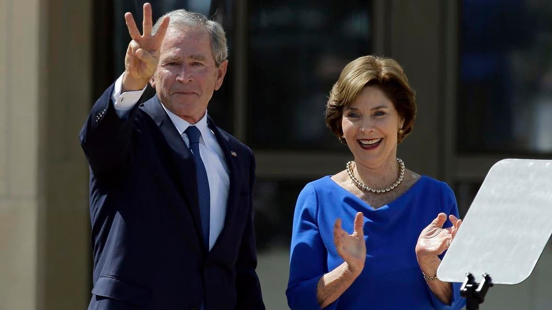 File photo of former President George W. Bush, accompanied by his wife, former first lady Laura Bush. (AP)