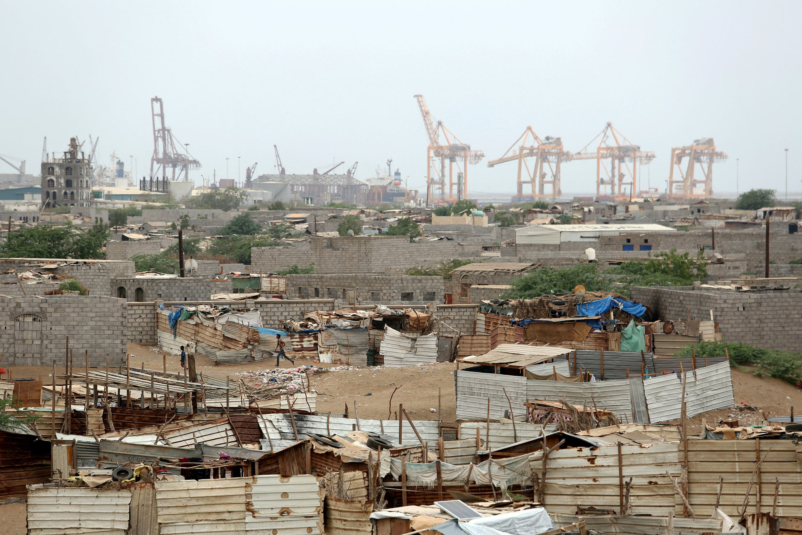 Hodeidah port's cranes pictured from a nearby shantytown on June 16, 2018. (Reuters)