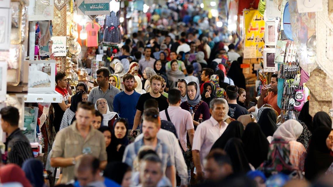 People walk through Tehran's ancient Grand Bazaar in Tehran on July 28, 2018. (AFP)