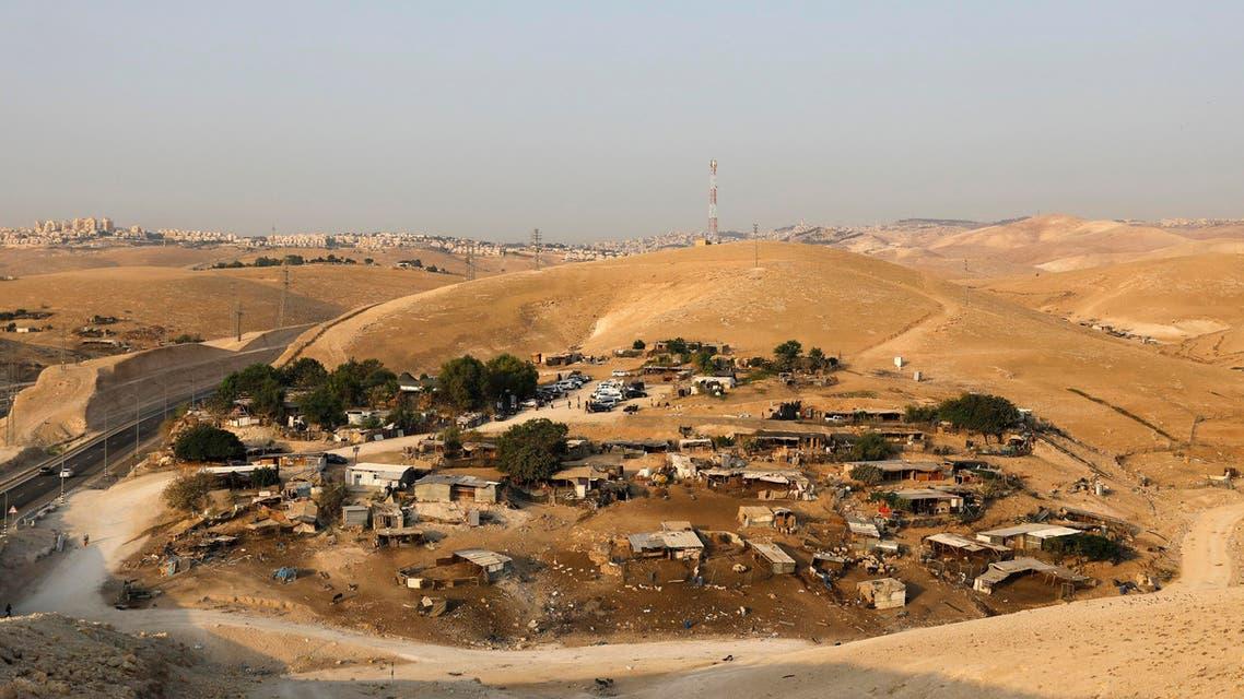 Khan al-Ahmar is beside an Israeli highway that runs through the West Bank from Jerusalem to the Dead Sea. (AFP)
