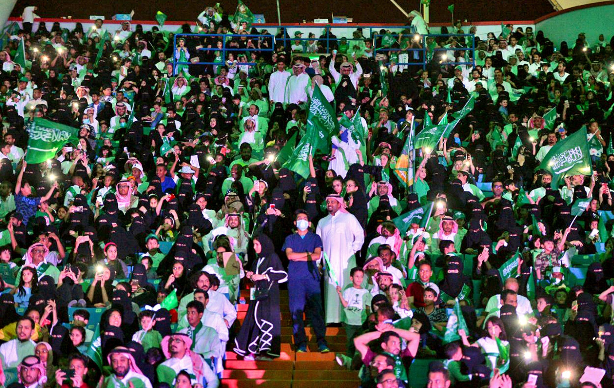 Saudi men and women attend the national day ceremonies at the King Fahd stadium in Riyadh on September 23, 2017. (Saudi Press Agency via AP)