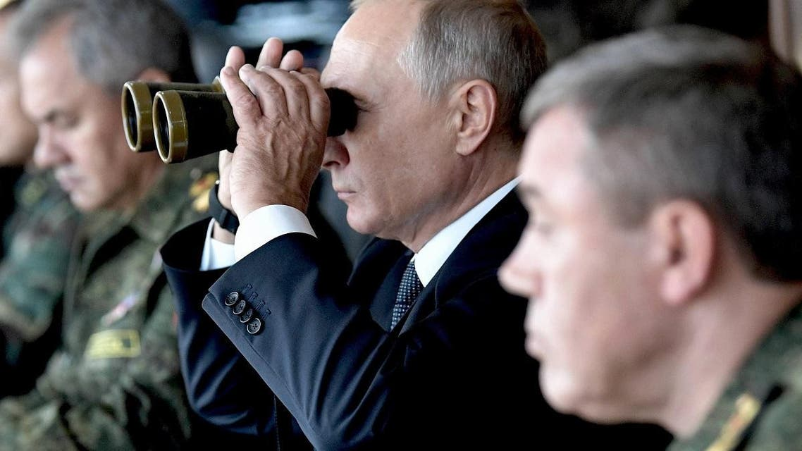 Russia's President Vladimir Putin (C), Defence Minister Sergei Shoigu (L) and Chief of the General Staff of Russian Armed Forces Valery Gerasimov oversee the Vostok-2018 (East-2018) military drills at Tsugol firing range in Zabaikalsky Region, Russia September 13, 2018. (Reuters)