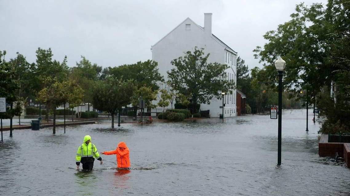 Residents walk in flooded streets as the Neuse River floods its banks during Hurricane Florence on September 13, 2018 in New Bern, North Carolina. (AFP)