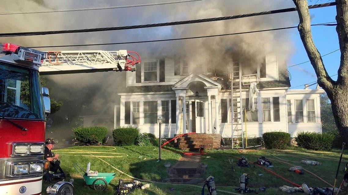 Firefighters battle a house fire, on Thursday, September 13, 2018, on Herrick Road in North Andover, Massachusetts. (AP)
