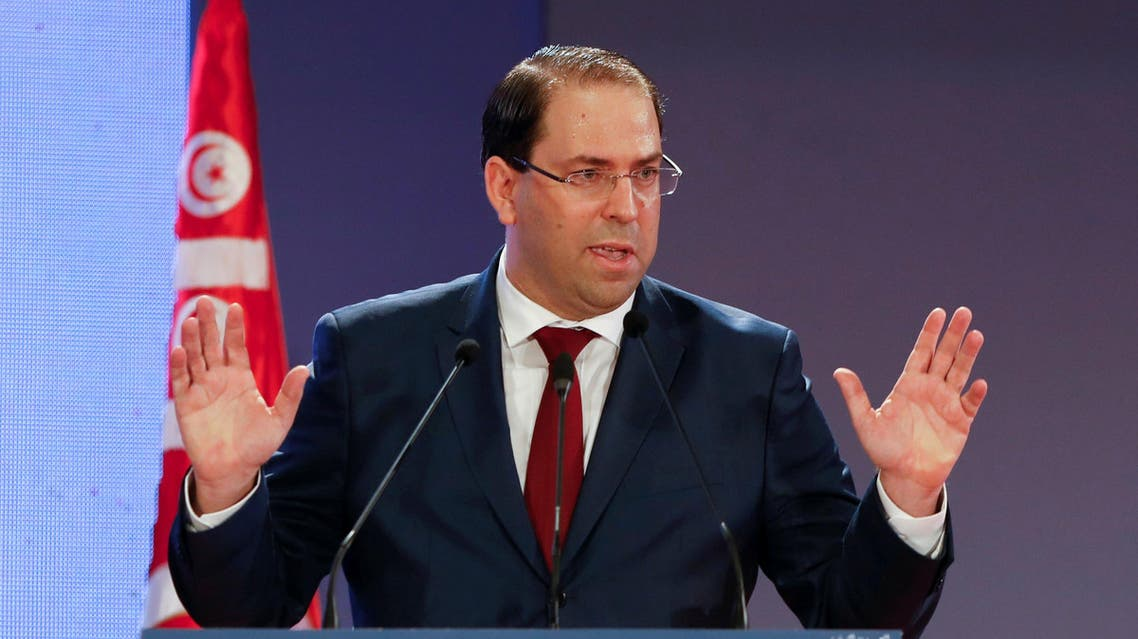 Tunisia's Prime Minister Youssef Chahed gestures as he speaks during a national conference over 2019 budget in Tunis, Tunisia, September 14, 2018. REUTERS/Zoubeir Souissi