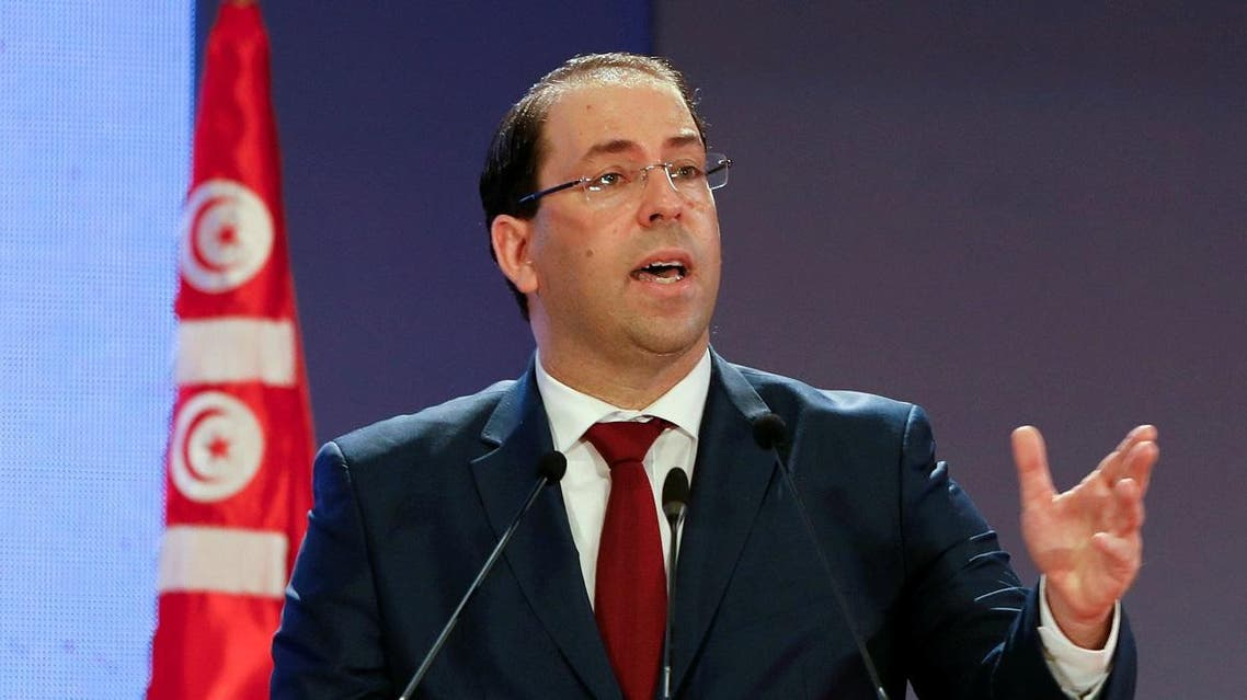 Tunisia's Prime Minister Youssef Chahed speaks during a national conference over 2019 budget in Tunis. (Reuters)