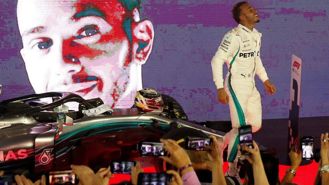Mercedes' Lewis Hamilton celebrates after winning the race at  the Singapore Grand Prix - Marina Bay Street Circuit, on September 16, 2018. (Reuters)
