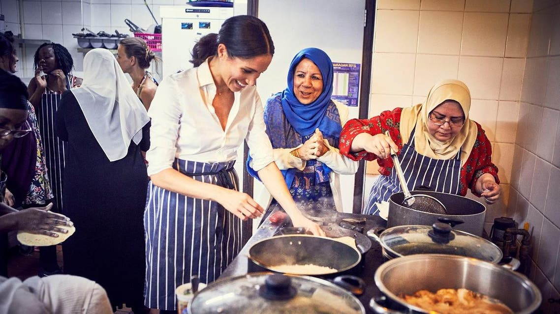 Britain's Meghan, Duchess of Sussex, cooks with women in the Hubb Community Kitchen at the Al Manaar Muslim Cultural Heritage Centre in west London. (Jenny Zarins via Reuters))