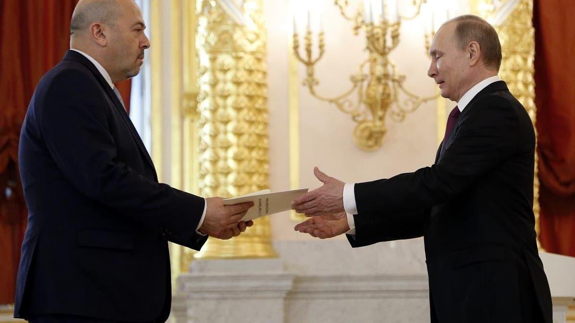 Israeli ambassador to Russia Gary Koren and Vladimir Putin. (AP)