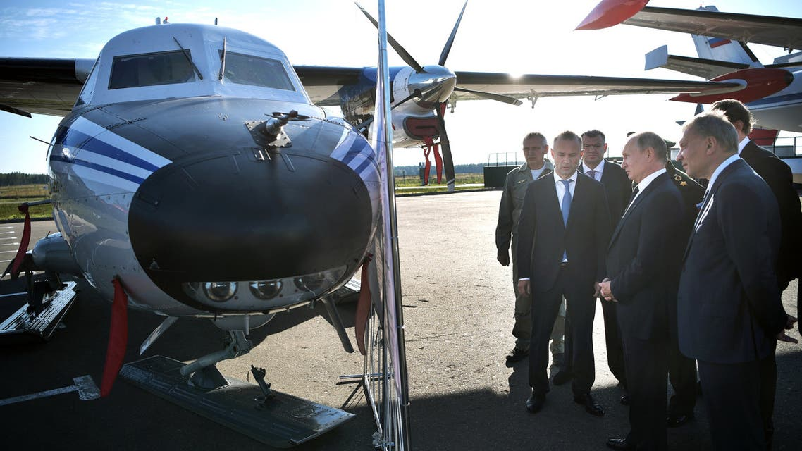 Russian President Vladimir Putin accompanied by Deputy Prime Minister Yuri Borisov and Alexander Bortnikov, the director of the Federal Security Service (FSB), watches a Let L-410 UVP-E20 Turbolet transport aircraft during a visit to Patriot military theme park outside Moscow, Russia September 19, 2018. Sputnik/Alexei Nikolsky/Kremlin via REUTERS ATTENTION EDITORS - THIS IMAGE WAS PROVIDED BY A THIRD PARTY.
