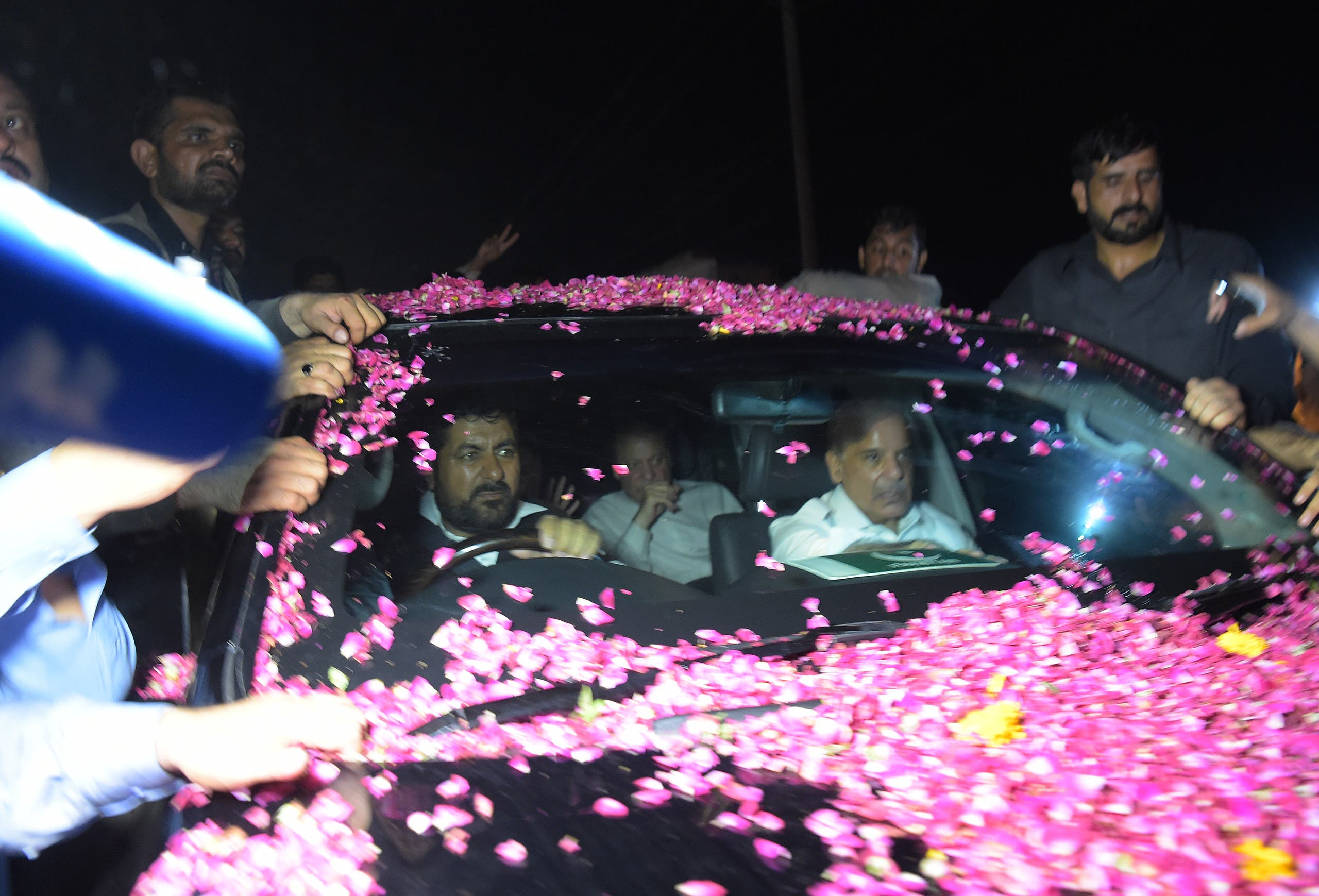 Former Pakistani Prime Minister Nawaz Sharif (C/ back) sits in a vehicle alongside his younger brother Shahbaz Sharif (R) following his release from Adiala prison in Rawalpindi on September 19, 2018.