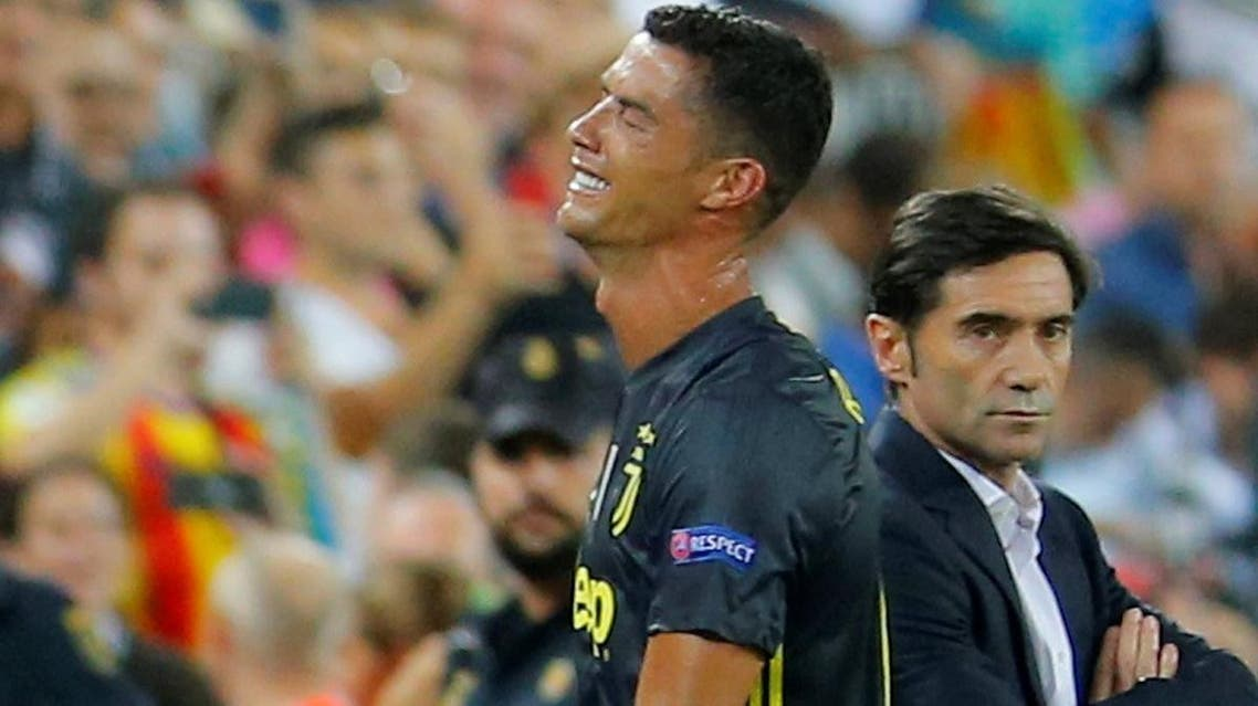Juventus' Cristiano Ronaldo reacts after he is sent off while Valencia coach Marcelino Garcia looks on. (Reuters)