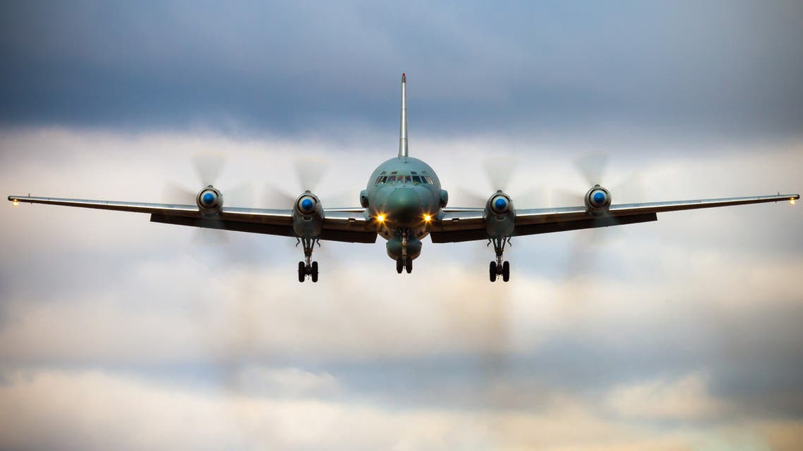 """A photo taken on July 23, 2006 shows an Russian IL-20M (Ilyushin 20m) plane landing at an unknown location. Russia blamed Israel on September 18, 2018 for the loss of a military IL-20M jet to Syrian fire, which killed all 15 servicemen on board, and threatened a response. Israeli pilots carrying out attacks on Syrian targets """"used the Russian plane as a cover, exposing it to fire from Syrian air defences,"""" a statement by the Russian military said."""