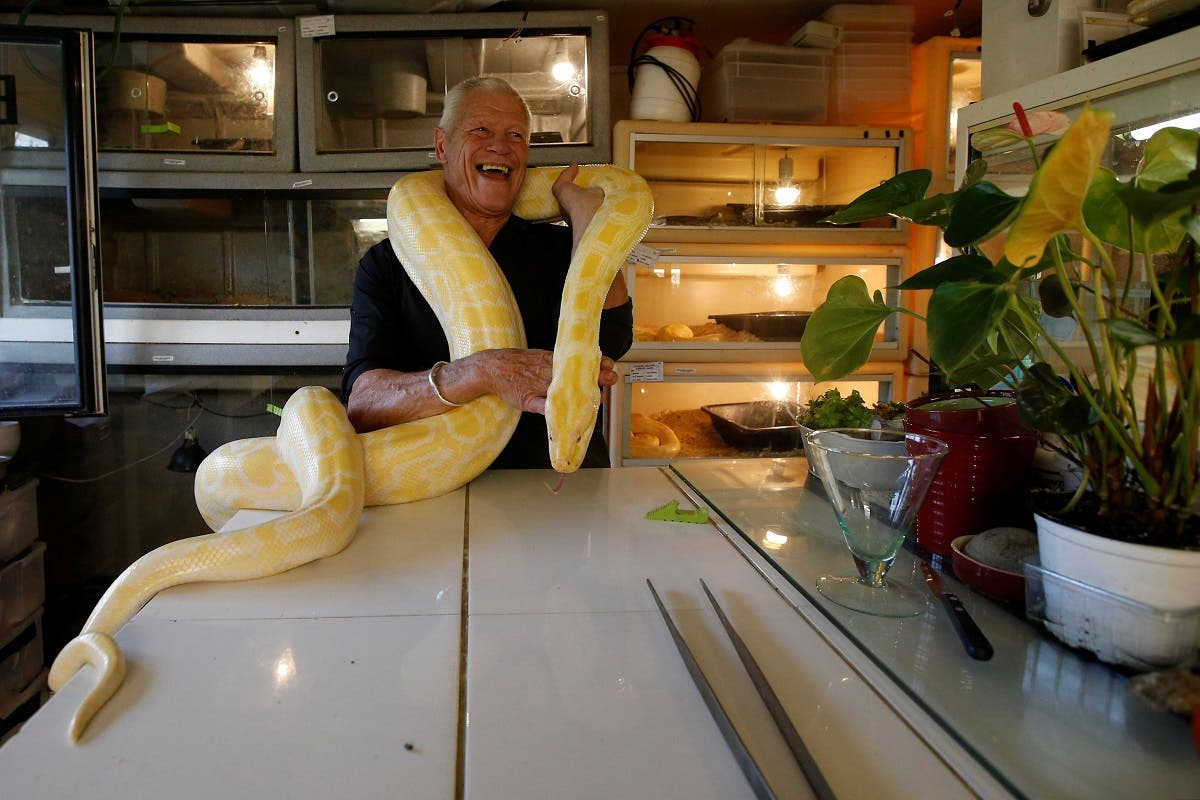 French man living with 400 reptiles. (Reuters)