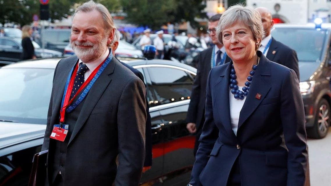 Britain's Prime Minister Theresa May and Britain's Permanent Representative to the EU Tim Barrow arrive for the informal meeting of European Union leaders ahead of the EU summit, in Salzburg, Austria, September 19, 2018. (Reuters)
