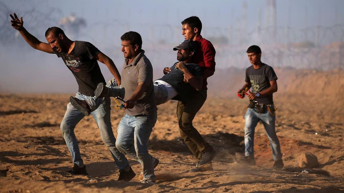 A wounded Palestinian is evacuated during a protest calling for lifting the Israeli blockade on Gaza  at the Israel-Gaza border fence, in the southern Gaza Strip on September 21, 2018. (Reuters)